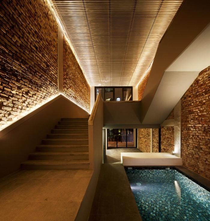 Iluminação paredes tijolo a vista