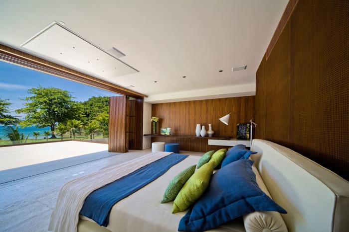 Quarto decoração parede de madeira vista para area gourmet